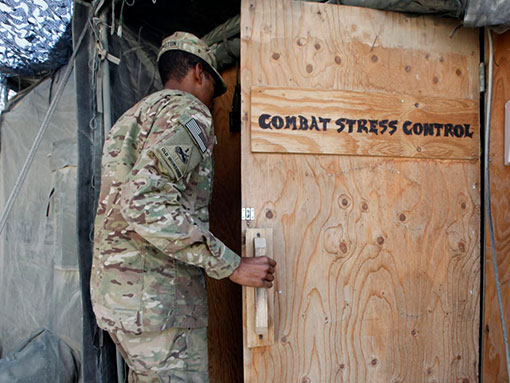 man in military opening door of combat stress control